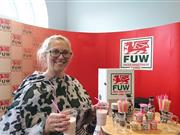 FUW Ceredigion County Executive Officer Mared Rand Jones promotes benefits of milk and udder-things at Aberystwyth University Freshers Fair