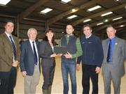 Dairy farmer Iwan Francis accepts his award at the Welsh Dairy Show