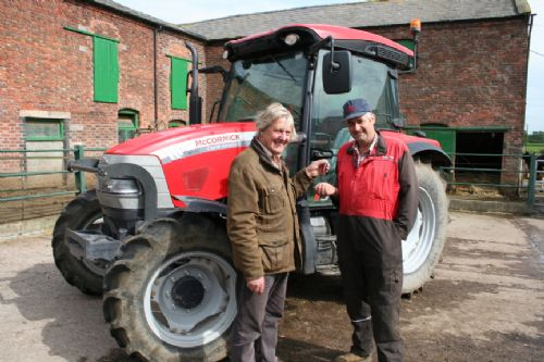 Will Charnley (left) of John Charnley & Sons with dairy farmer David Lomas and his 100hp McCormick CX110 XtraShift.