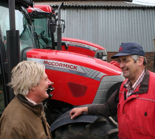 Will Charnley (left) of John Charnley & Sons with dairy farmer David Lomas and two of his McCormick tractors – a 112hp MC115 and the 100th McCormick supplied by Charnleys, a 100hp CX110 XtraShift.