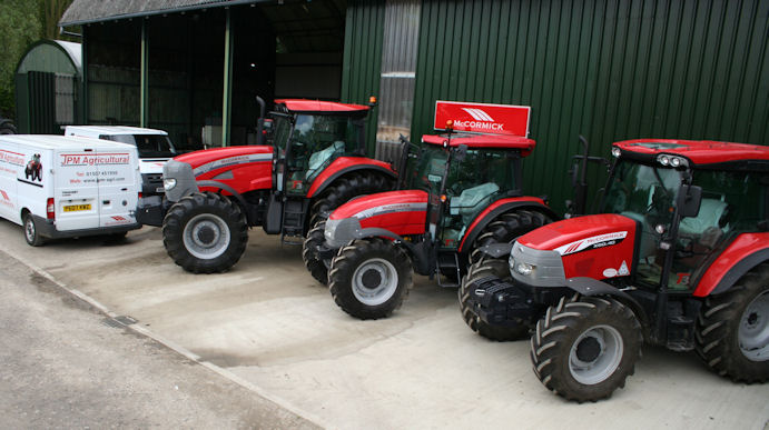 A line-up of McCormick tractors outside the workshops, parts store and new retail area at JPM Agricultural