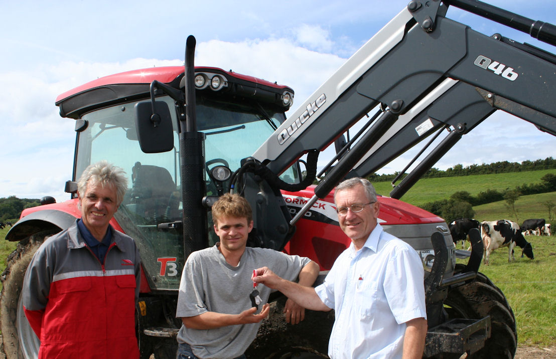 Brian Yeates (right) and Richard Read of Read Agriservices present first McCormick customer Nick Hutton with the keys to the new McCormick X60 tractor he and his brother Ben have put to work on their 280-cow dairy enterprise.