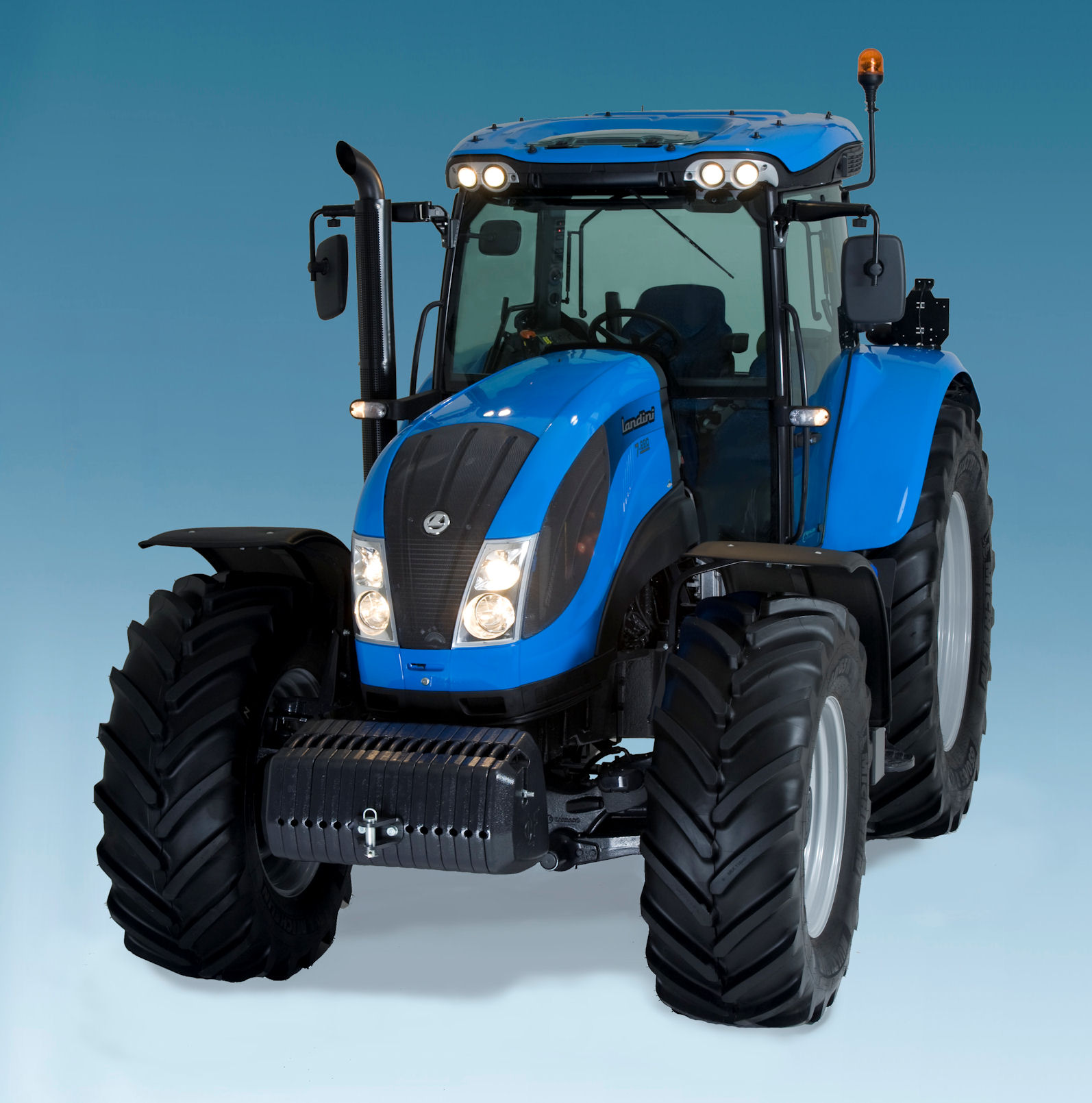 The new tractors are most easily distinguished by the bright-work finish of the work lights and the cab roof window.