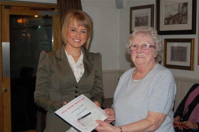 MEMORIAL AWARD: Harley-Blue Clarke-Stead receives the Walter Rowlands Memorial Award from his widow Mrs Nesta Rowlands.
