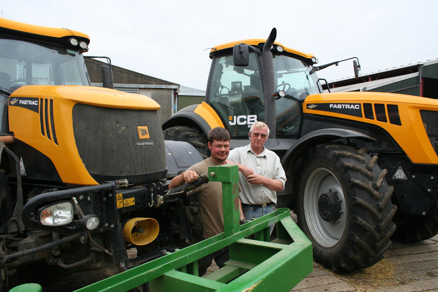 Graham Lawman and his son Andrew with their Fastrac tractors supplied by G & J Peck's Ramsey branch.