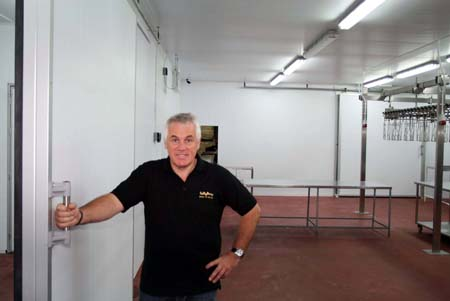 Paul Kelly checking the new facility  before processing begins