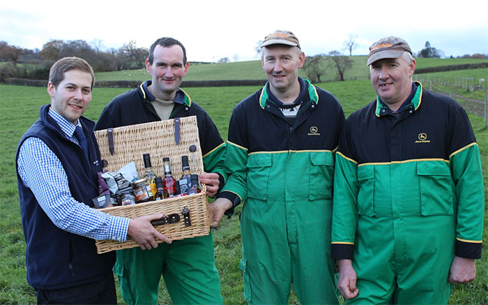 The Co-operative's Tom Webb presenting a hamper to Neil, Alan and David Pryce.