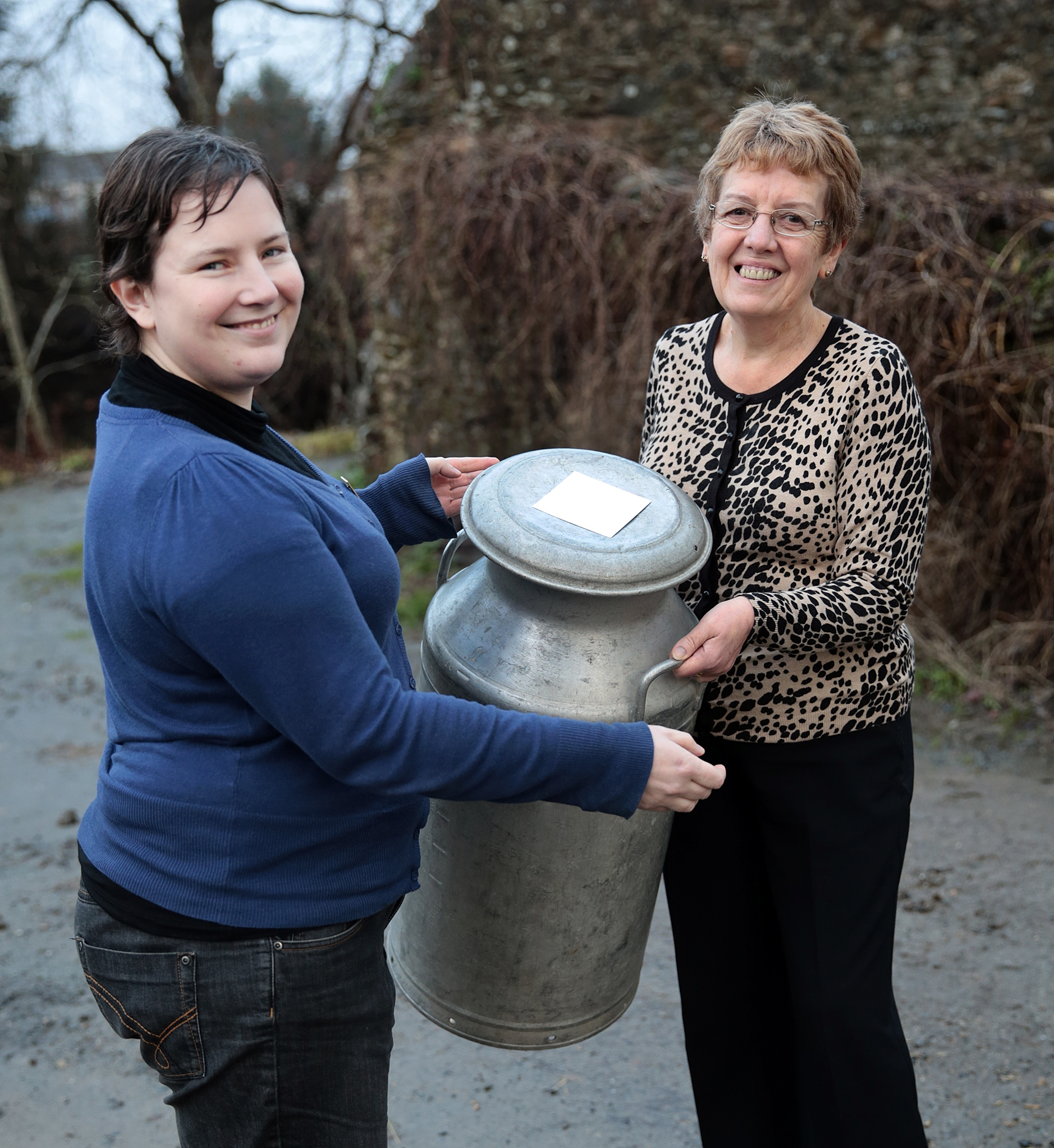 FUW Carmarthenshire county chairman Catherine Nakielny (left) presents Meinir Bartlett with her retirement milk churn present.