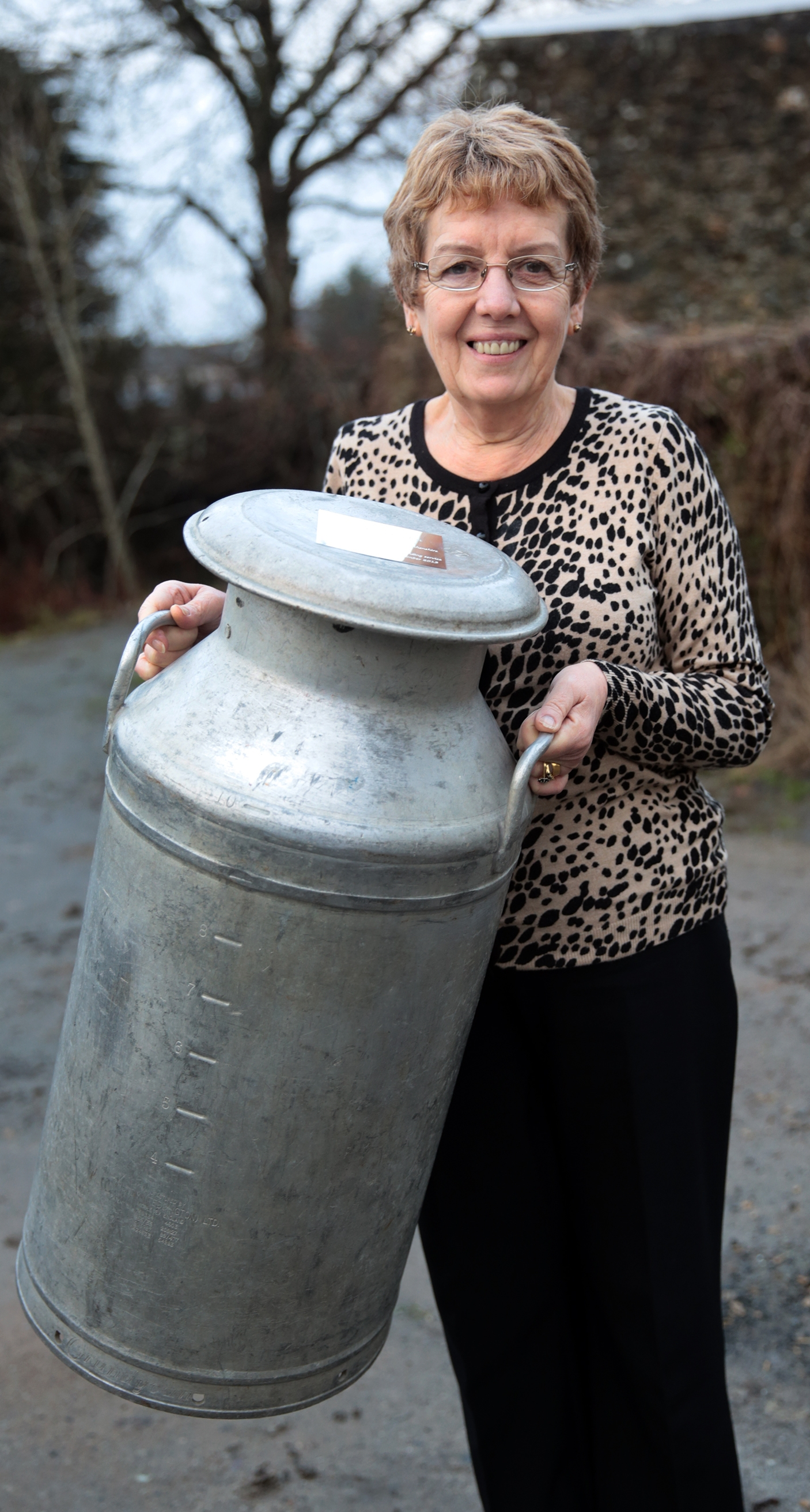 Meinir Bartlett with her milk churn.