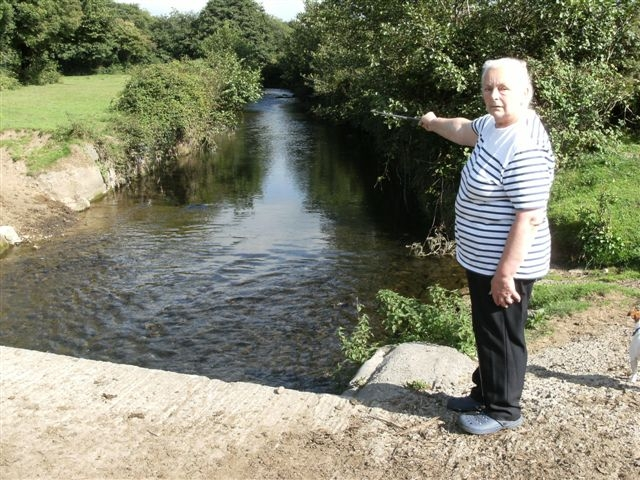 Beatrice Hayball-Jones alongside the section of river that runs through her farm at Treoes in the Vale of Glamorgan.