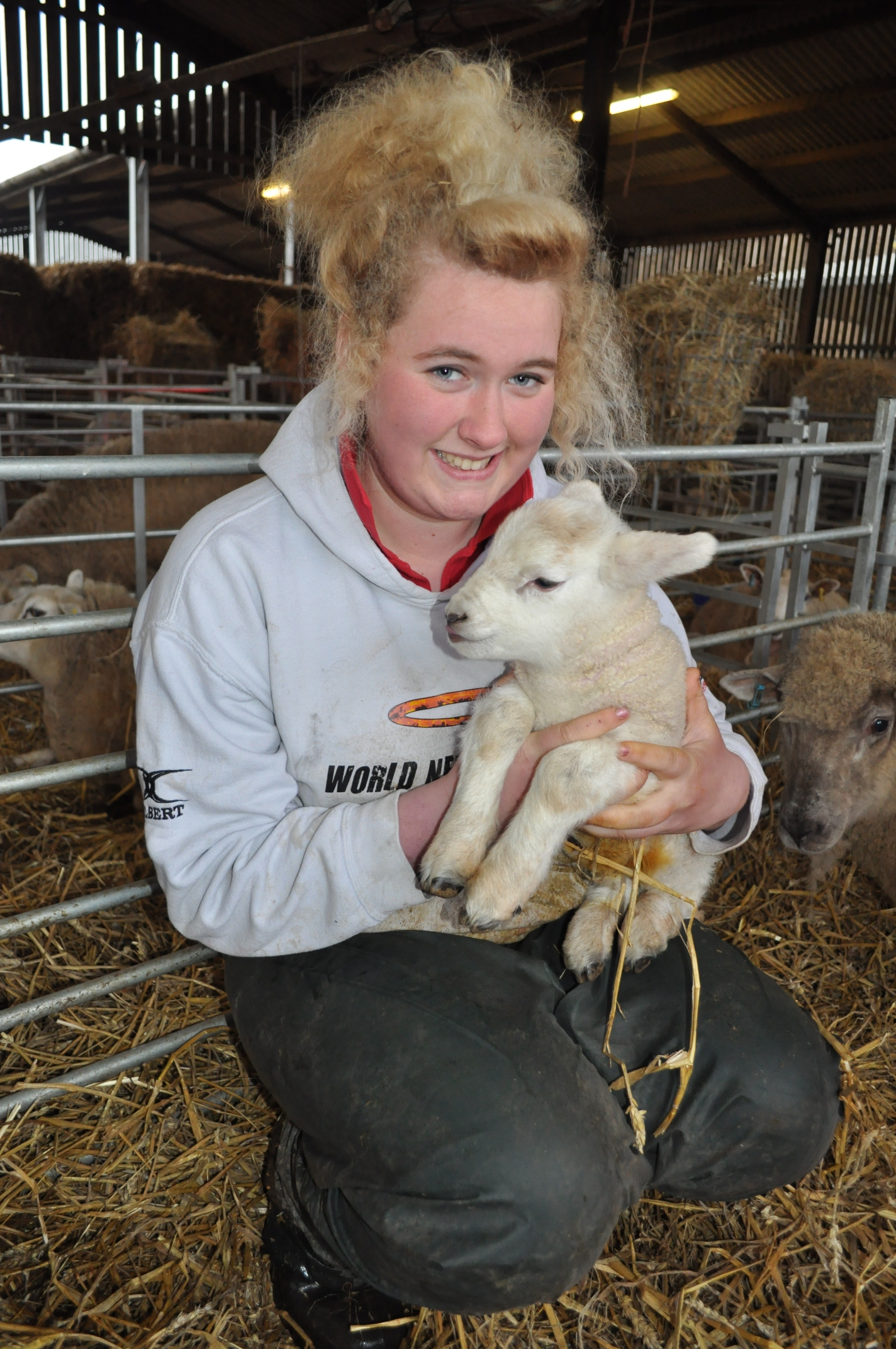 Level 3 Agriculture student, Sophie Lewis holding a lamb