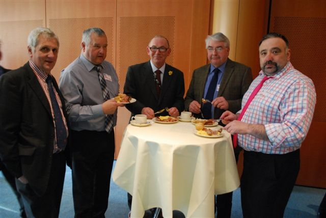 From left, FUW deputy president Glyn Roberts, FUW finance and organisation committee member Eifion Huws, Andrew Aggett, and Meirionnydd delegation members Dewi Owen and John Roberts.