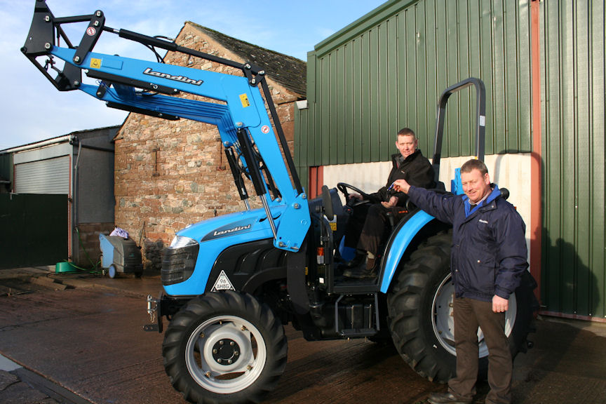 Tony Blackburn of Newton Trailer Centre (right) hands over the keys for the new Landini 1-55M tractor to Buttermere sheep farmer Alan Beard.