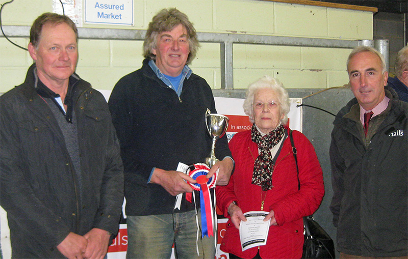 Robin Maund Cup winner Martin Jones (second from left) pictured with (from left) judge Adrian Jones, cup donor Barbara Maund and Halls' director and dairy specialist David Giles.