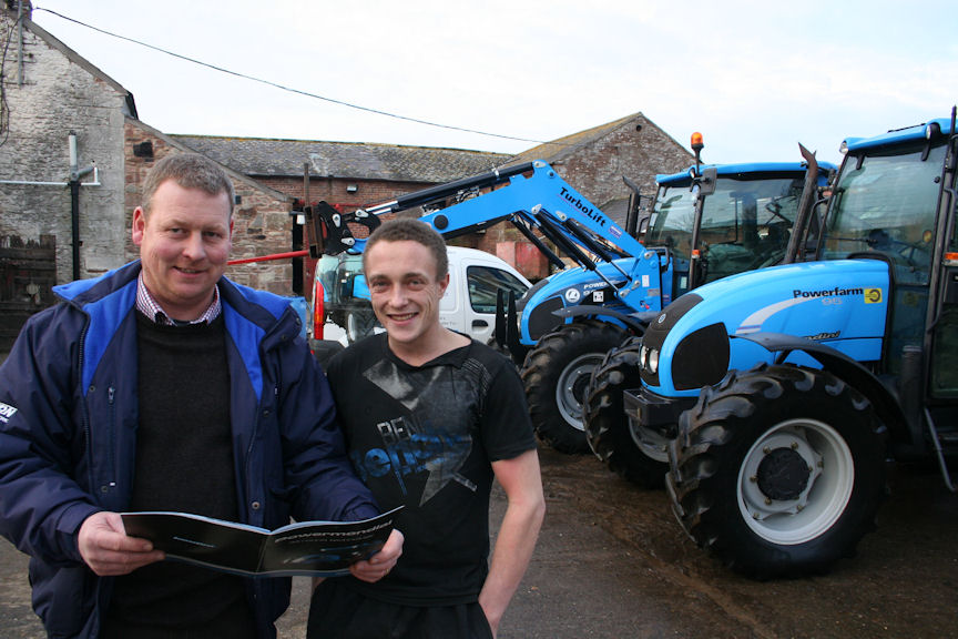 Tony Blackburn (left) of Newton Trailer Centre tempts Will Hornsby with a look through the Landini tractor catalogue.