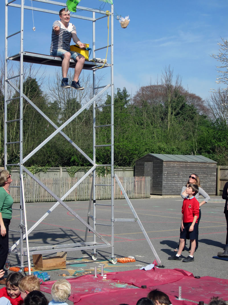 Children made parachutes for eggs which were dropped from a scaffold to see if they would survive the fall.