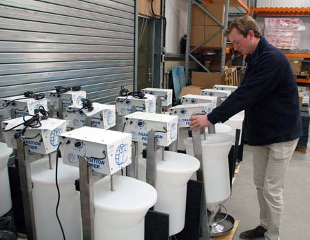 QE's Henry Stark checks over a consignment of Transition feeders for export. The feeders are sold worldwide.