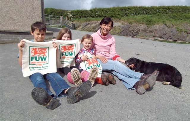 Farmer's wife Angharad Rowlands of Rhosgoch Farm, Capel Dewi, near Aberystwyth, with her children Aneurin (11), Martha (7) and Elan (3) and dog Floss. The children are holding reusable campaign cotton bags.