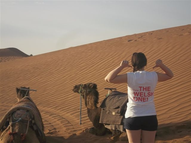 "Sian in the Sahara Desert wearing an FUW ""Help Cut Food Miles...Buy The Welsh One"" campaign tee-shirt."