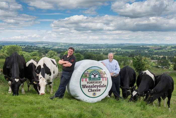 Wensleydale dairy farmer Kevin Clarkson (Left) and Wensleydale MD David Hartley (right) celebrate Le Grand Fromage!