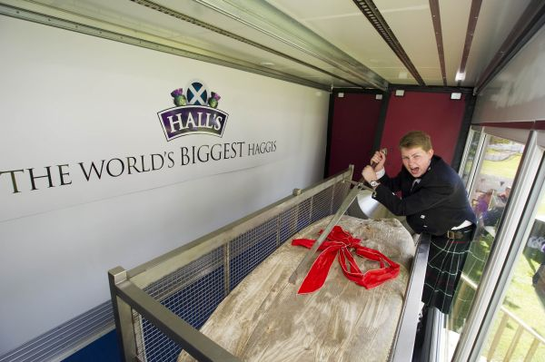 15-year-old Cameron Hill from Kilmarnock cuts into the record-breaking haggis