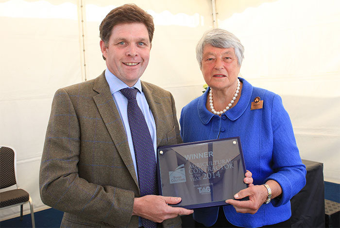 Dame Janet Trotter DBE HML presents the award to Patrick Gething Lewis of Gamber Cleaning Services