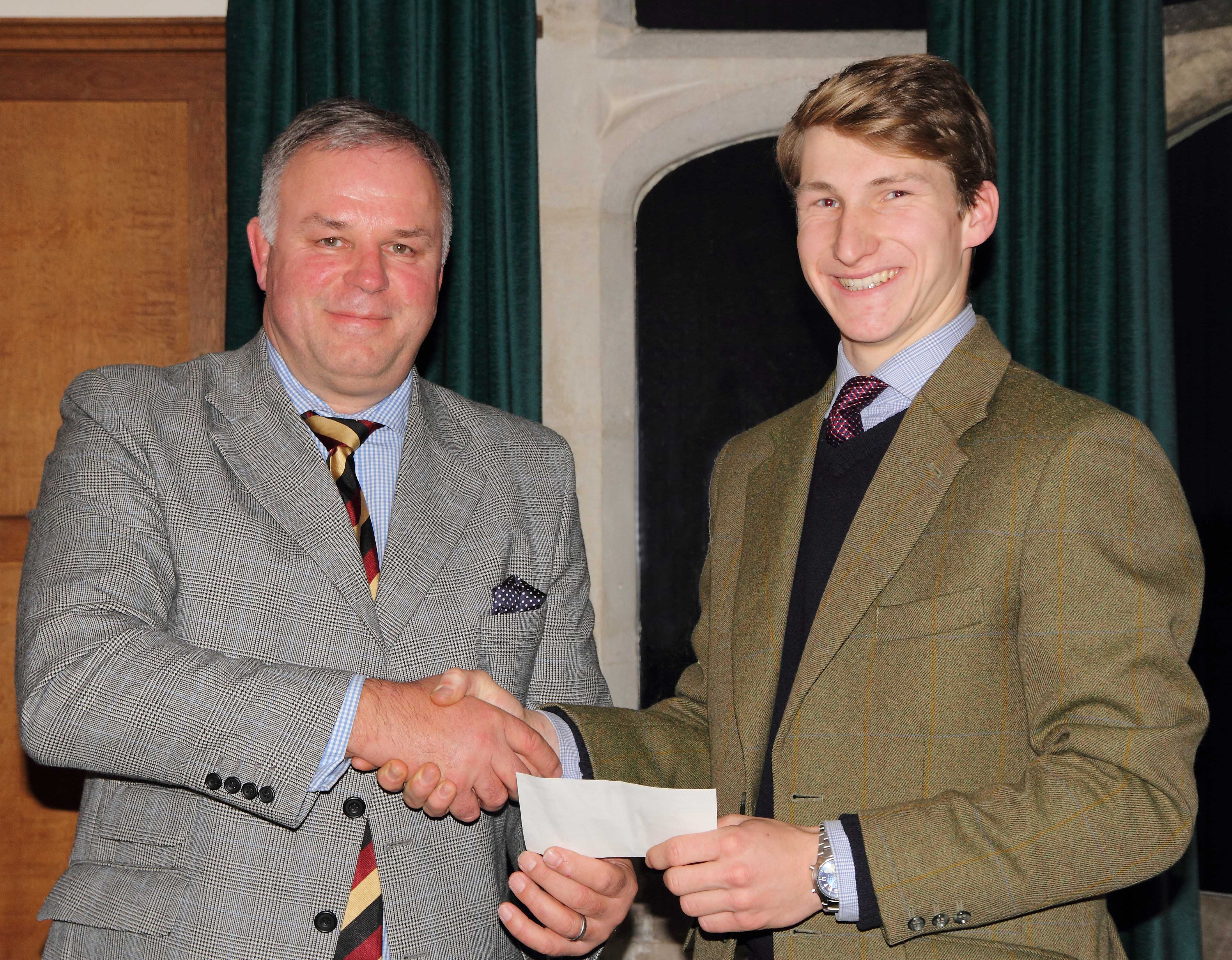 Andrew Jackson, managing partner at Fisher German, presents Tom Vacher with his cheque as part of the Henry Sale Graduate Bursary