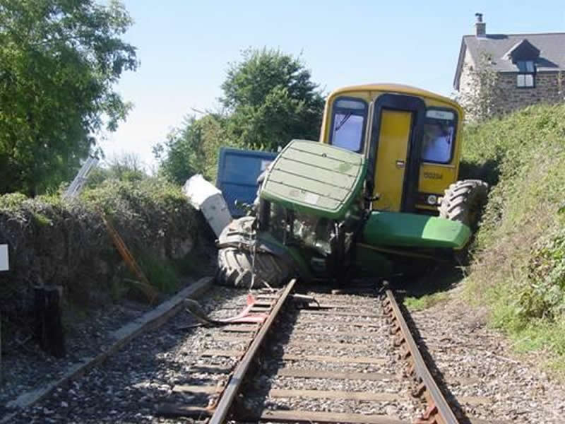 Tractor Splitting Rails : Farmers urged not to come a crop per on level crossing
