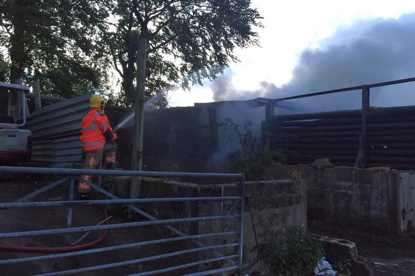 Firefighters tackle barn fire at 101-year-old farm in Bury, arson blamed