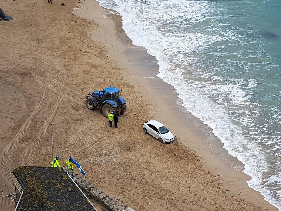 Farmer rescues stricken elderly driver on Newquay beach