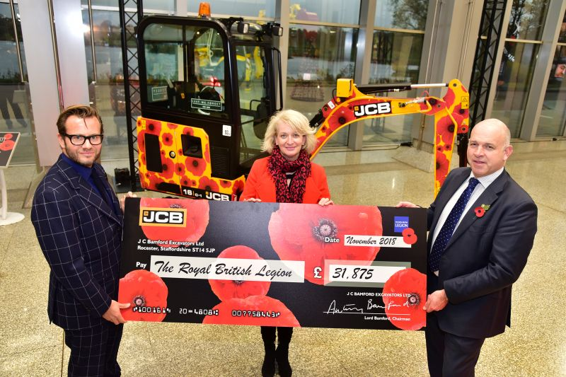 George Bamford (left), presents Annmarie Jones and Simon O'Leary, of the Royal British Legion with a cheque for £31,87