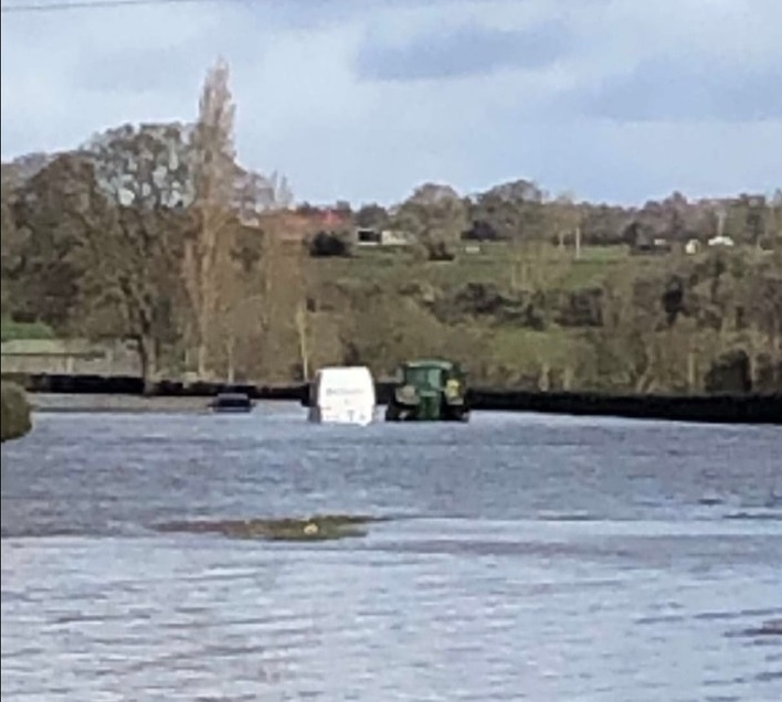Farmers help stranded motorists and move sheep after flooding