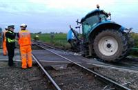 Review into train gates urged after tractor collision