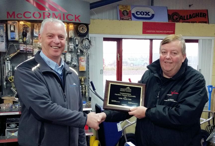 Bob Bain of AgriArgo UK (left) presents a commemorative plaque to David Walkinshaw of Hamilton Tractors.
