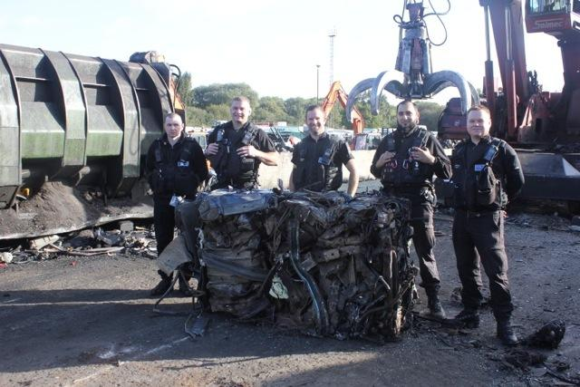 North Yorkshire police with the crushed Land Rover Discovery...