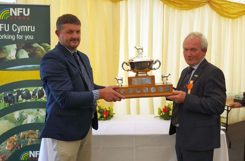 Stephen James (right) has received the Idris Davies Memorial Award 2018 for his contribution to Welsh dairy farming