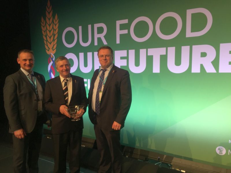 Lancashire farmer John Alpe (centre) has been honoured for his grassroots commitment to the NFU