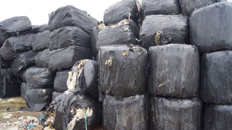 Waste is compressed into a block or 'bale' and concealed by plastic strapping