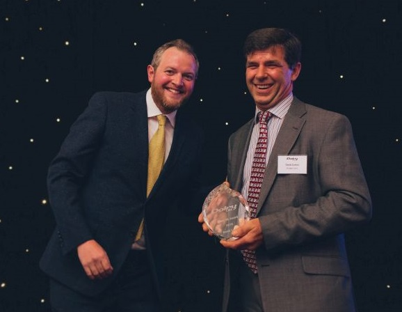 David Cotton (R), a fourth generation farmer, received the award for his dedication to the dairy industry