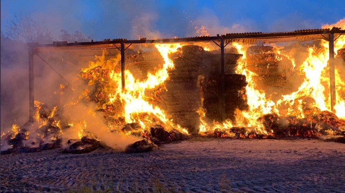 The blaze destroyed outbuildings and hundreds of tonnes of hay (Photo: Hardley Fire Station)