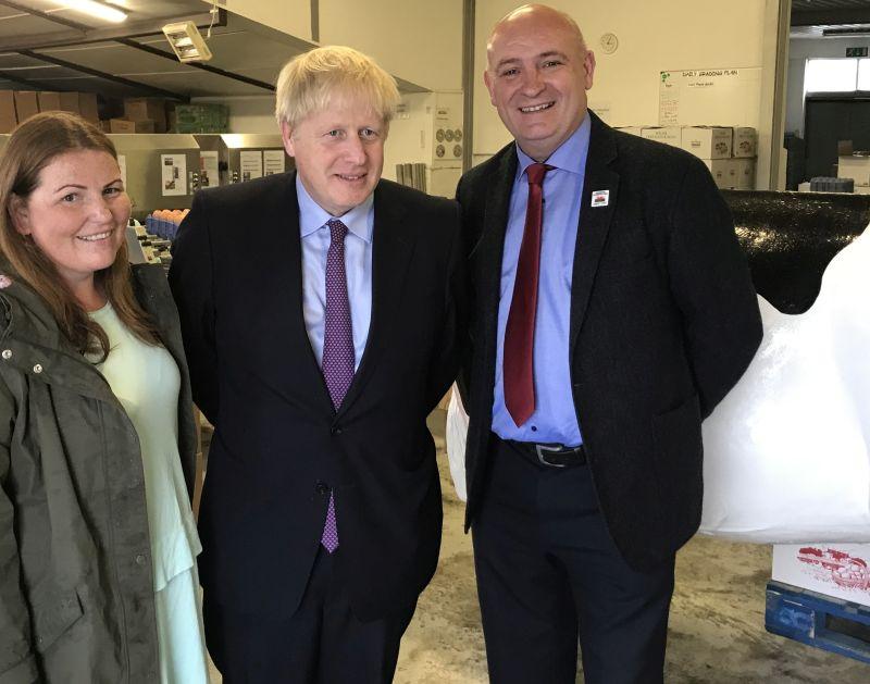 Boris Johnson with local farmer Victoria Shervington-Jones and NFU Cymru President, John Davies during yesterday's visit to Welsh farming businesses