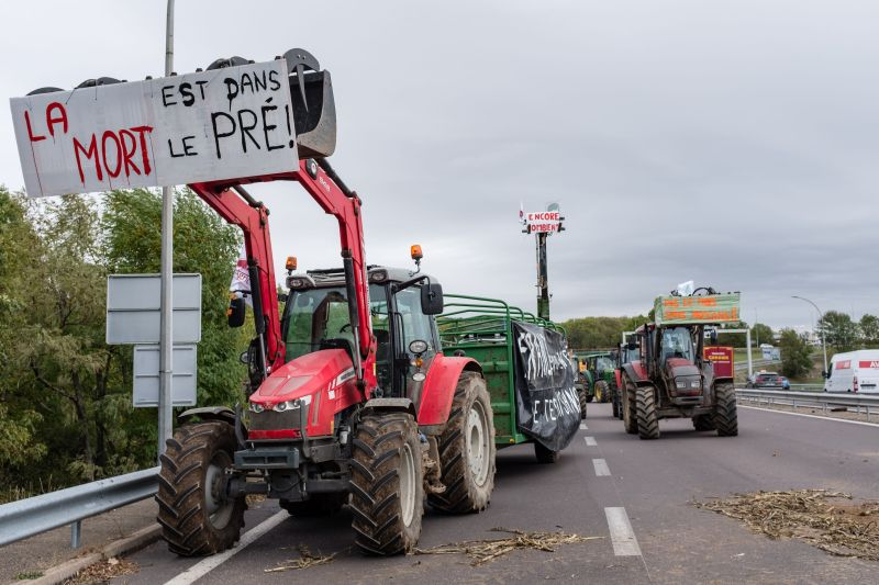 French farmers block the A6 highway entrance with their tractors, near Dijon, during a demonstration called by unions (Photo: KONRAD K/SIPA/Shutterstock)