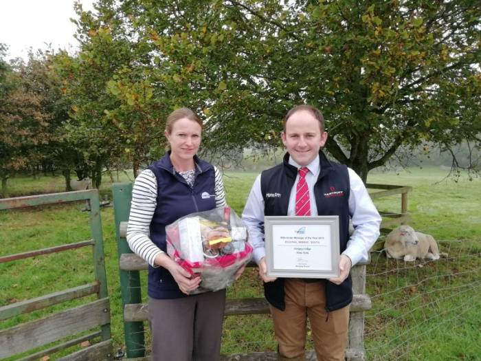 Caroline Groves, Senior Consultant at Promar, presents the award to Andrew Eastabrook, Farm Manager at Hartpur