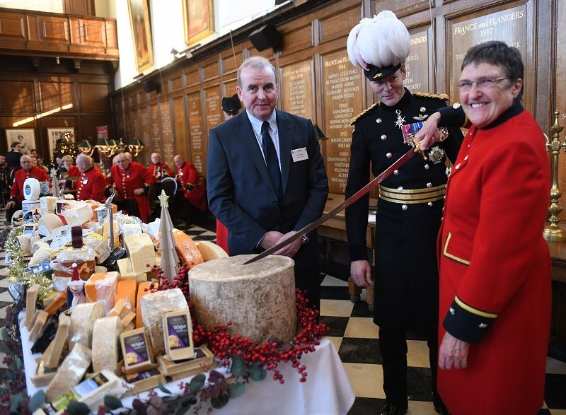 Chelsea Pensioner Monica Parrott, the first ever female Pensioner, cut the ceremonial Montgomery Cheddar