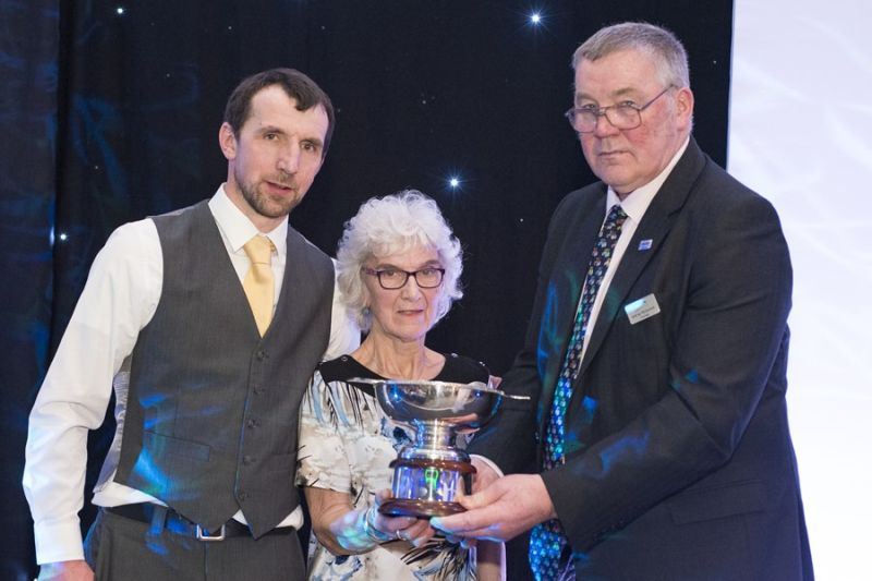 Jan Innes and son James collect the award from NFU Scotland President Andrew McCornick