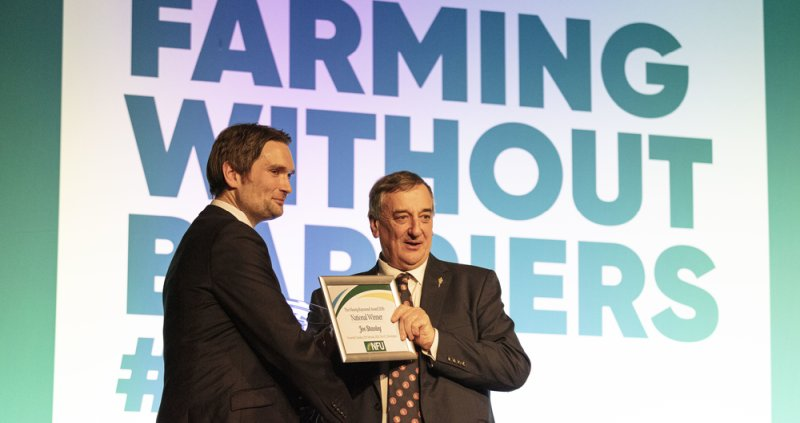Leicestershire farmer Joe Stanley (L) has been honoured for his dedication to advancing the British farming industry