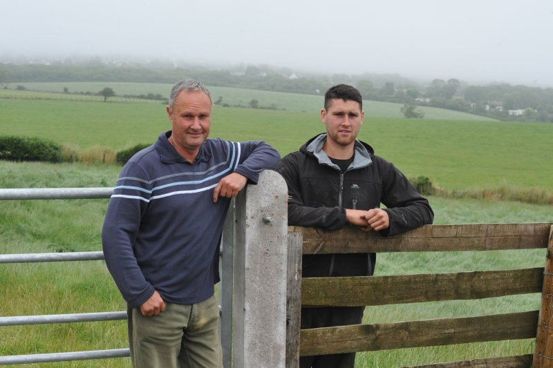 Beef finisher Edward Griffith (L) said he hopes to cut production costs with home-grown crimped barley