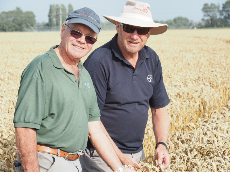 Eric Watson (L) broke the world record with a massive 17.398 tonne per hectare wheat crop
