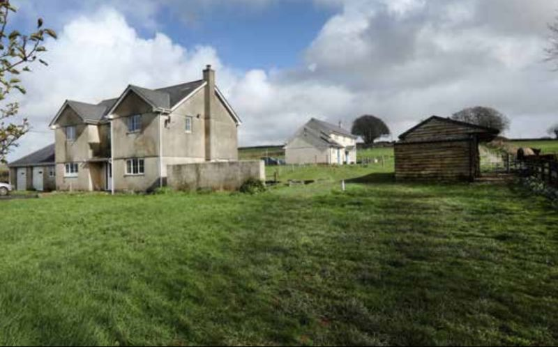 The property, on the market with Kivells, has a modern farmhouse with three/four bedrooms