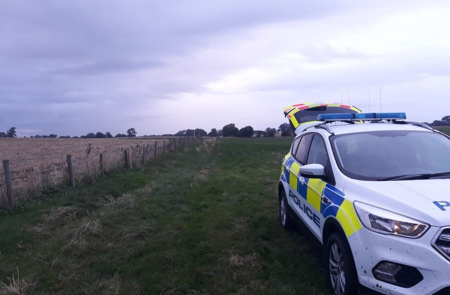 Police arrived at the scene and encountered three suspected poachers with dogs walking across a farm